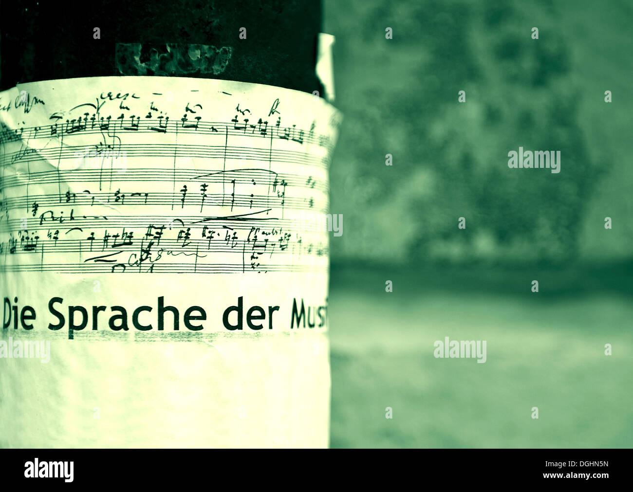 Placard on music, 'Die Sprache der Musik', German for 'Language of music - Stock Image