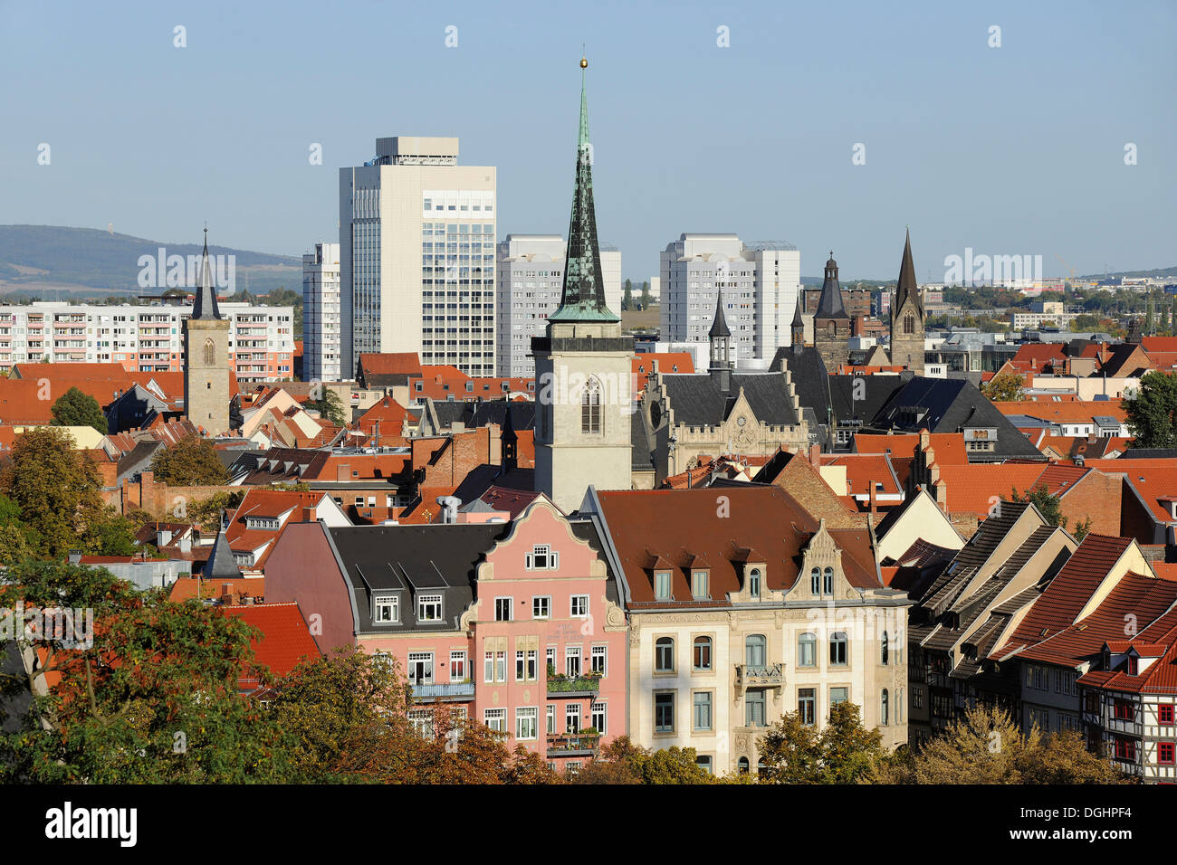 Town centre of Erfurt, spire of the All Saints' Church at front, town hall on the right, Erfurt, Thuringia, Germany - Stock Image