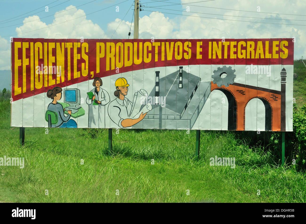 Revolutionary propaganda, Eficientes, procuctivos y integrales, Efficient, productive and industrious, near Las Tunas, Cuba - Stock Image