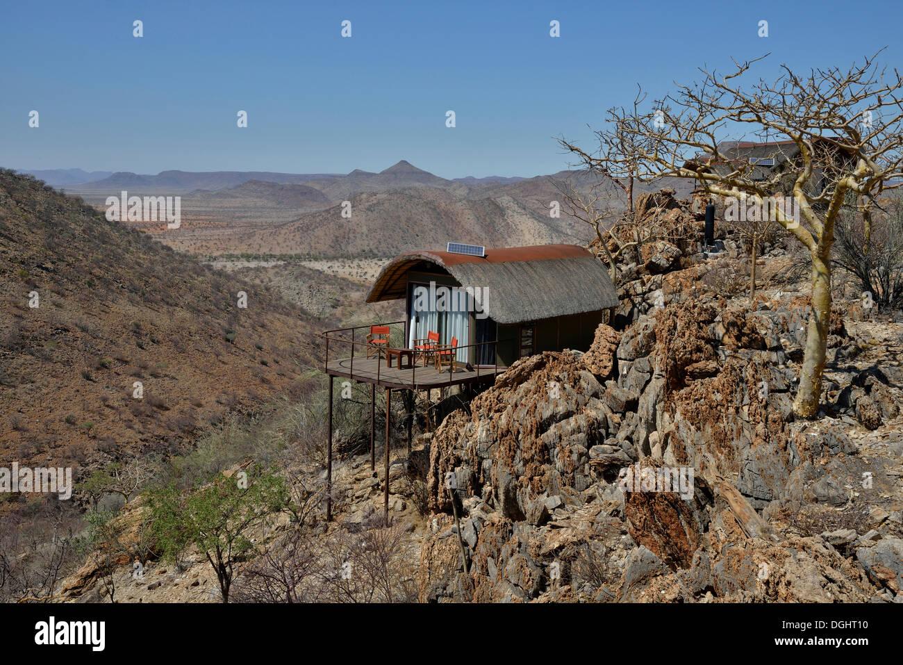 Etambura Camp, lodge run by Himba, bei Orupembe, near Orupembe, Kaokoland, Kunene, Namibia - Stock Image