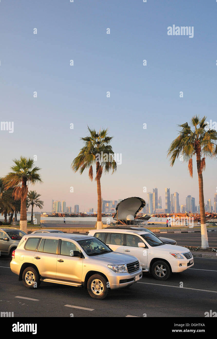 All-terrain vehicles on the Corniche in front of the Pearl and Oyster Fountain, Doha, Qatar, Middle East - Stock Image