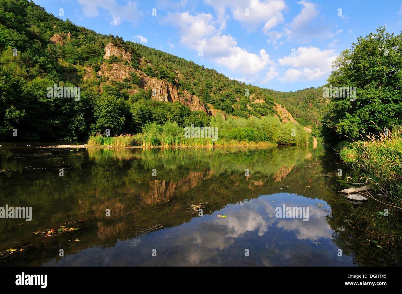 Reflections in the calm waters of the upper Loire River, Gorge de la Loire, Haute-Loire department, Auvergne, France - Stock Image