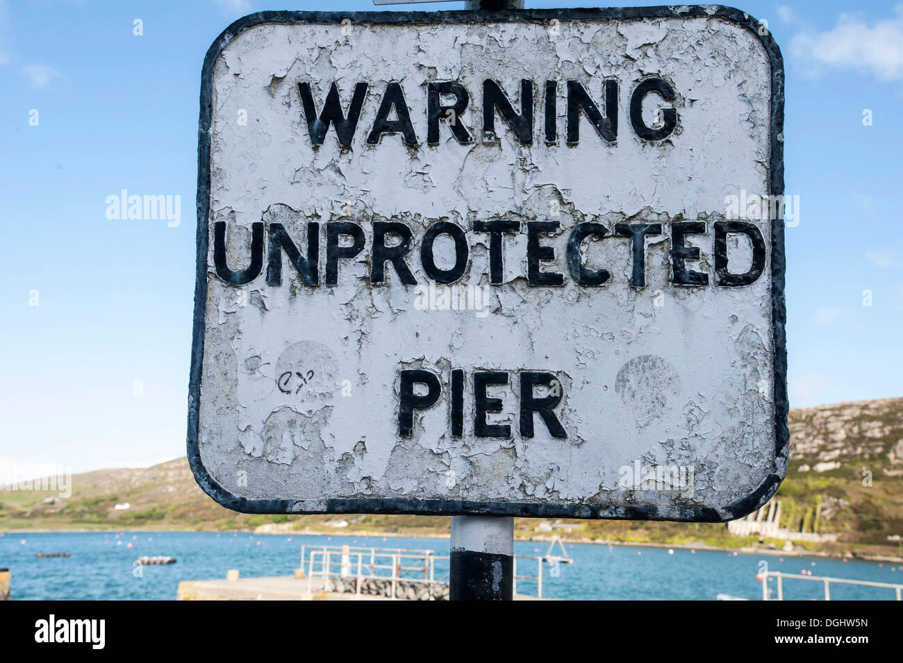 Warning sign, 'warning unprotected pier', Crookhaven, County Cork, Republic of Ireland, Europe - Stock Image