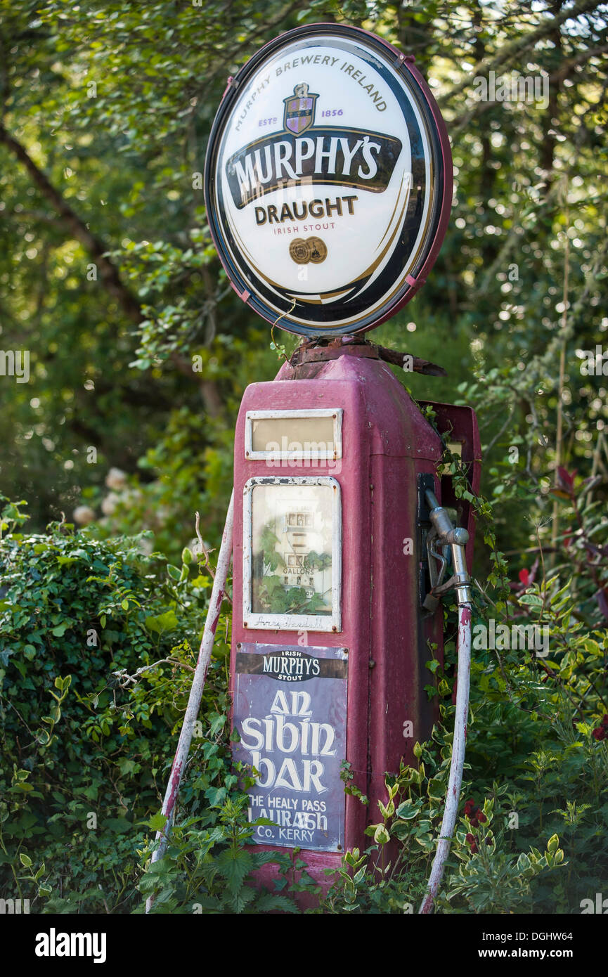 Old disused and overgrown fuel pump, 'The Sibin', Ring of Beara, Republic of Ireland, Europe - Stock Image