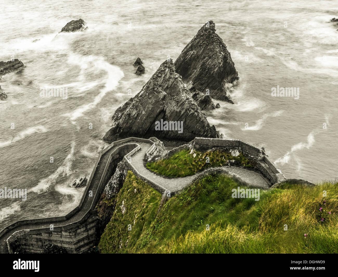 Steep curvy path to the ferry terminal, Dingle Peninsula, County Kerry, Republic of Ireland, Europe - Stock Image