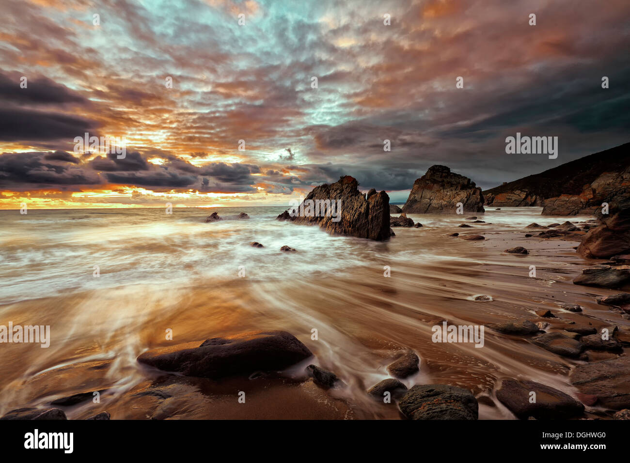 A view across the beach at Freathy. - Stock Image