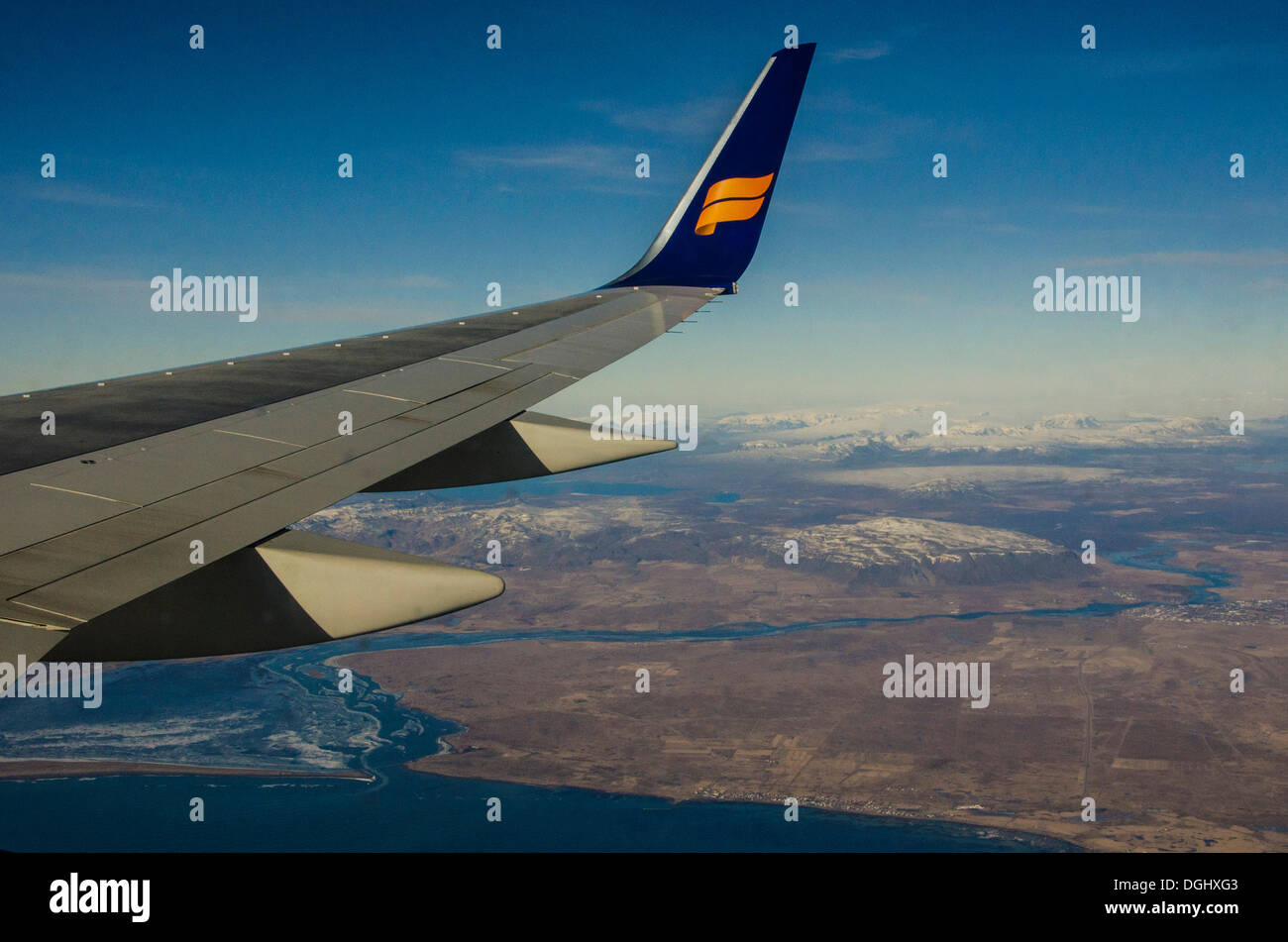 Wing of an airplane over Southern Iceland, landing approach to Reykjavik, Südisland, Iceland - Stock Image