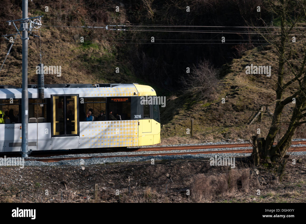 Metrolink tram in the river Beal valley, on the Oldham-Rochdale line, near Newhey, Rochdale, Manchester, England, UK. - Stock Image