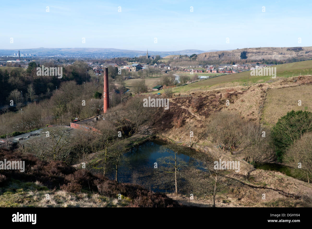 Old mill reservoir and chimney in the Beal valley, near Newhey, Rochdale, Greater Manchester, England, UK - Stock Image
