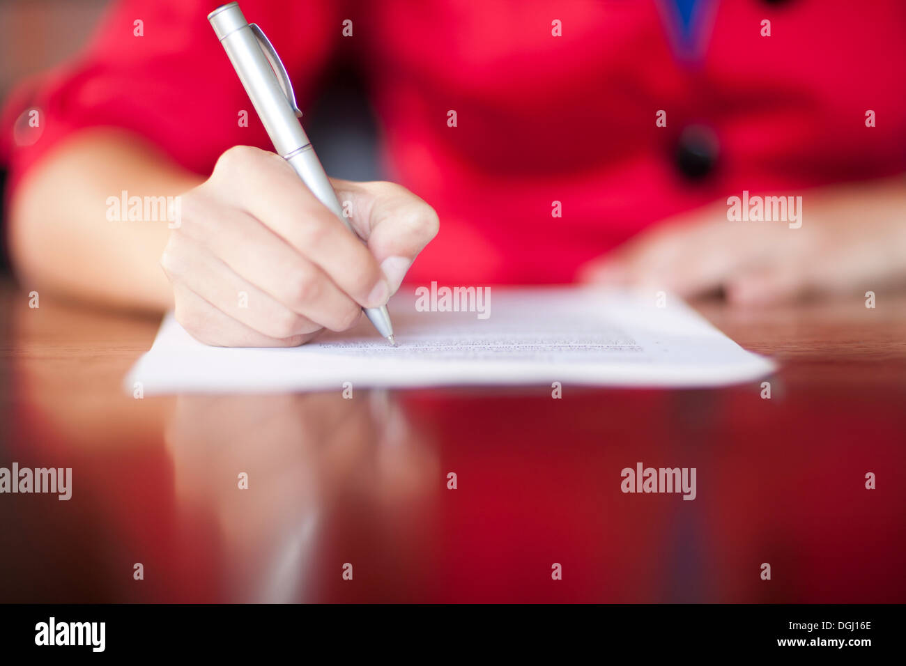 Woman writing, close up - Stock Image