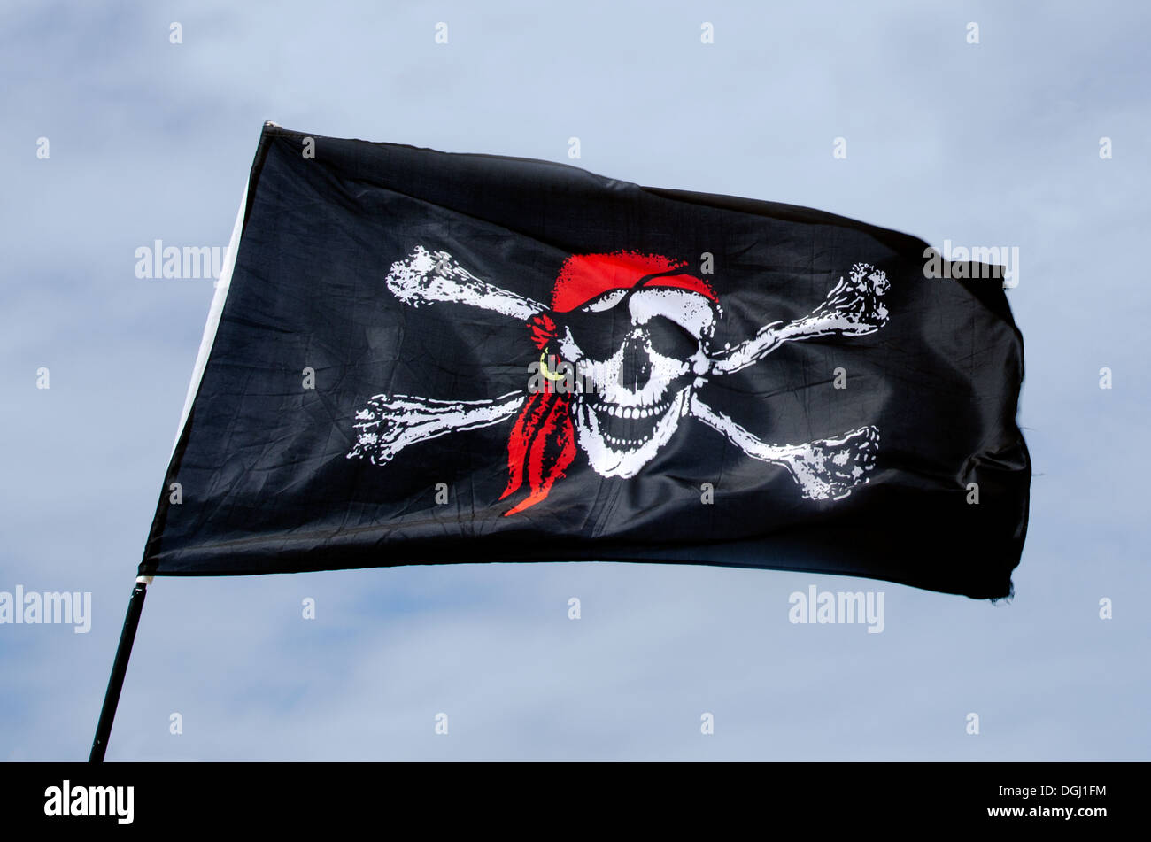 Jolly Roger, Pirates flag against blue sky. Stock Photo