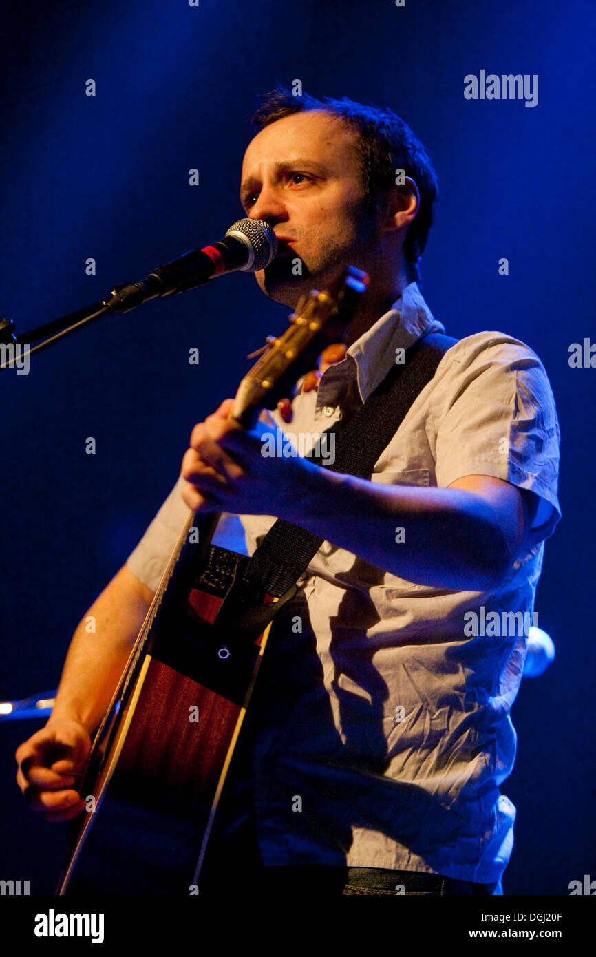 The French singer and songwriter Julien Pras live in the Treibhaus venue, Lucerne, Switzerland - Stock Image