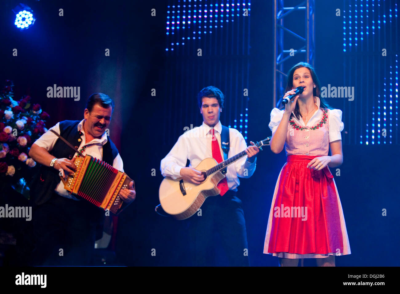 Swiss folk music and pop group Oesch's die Dritten performing live at the 10th Schlager-Night in the new Allmend Stock Photo