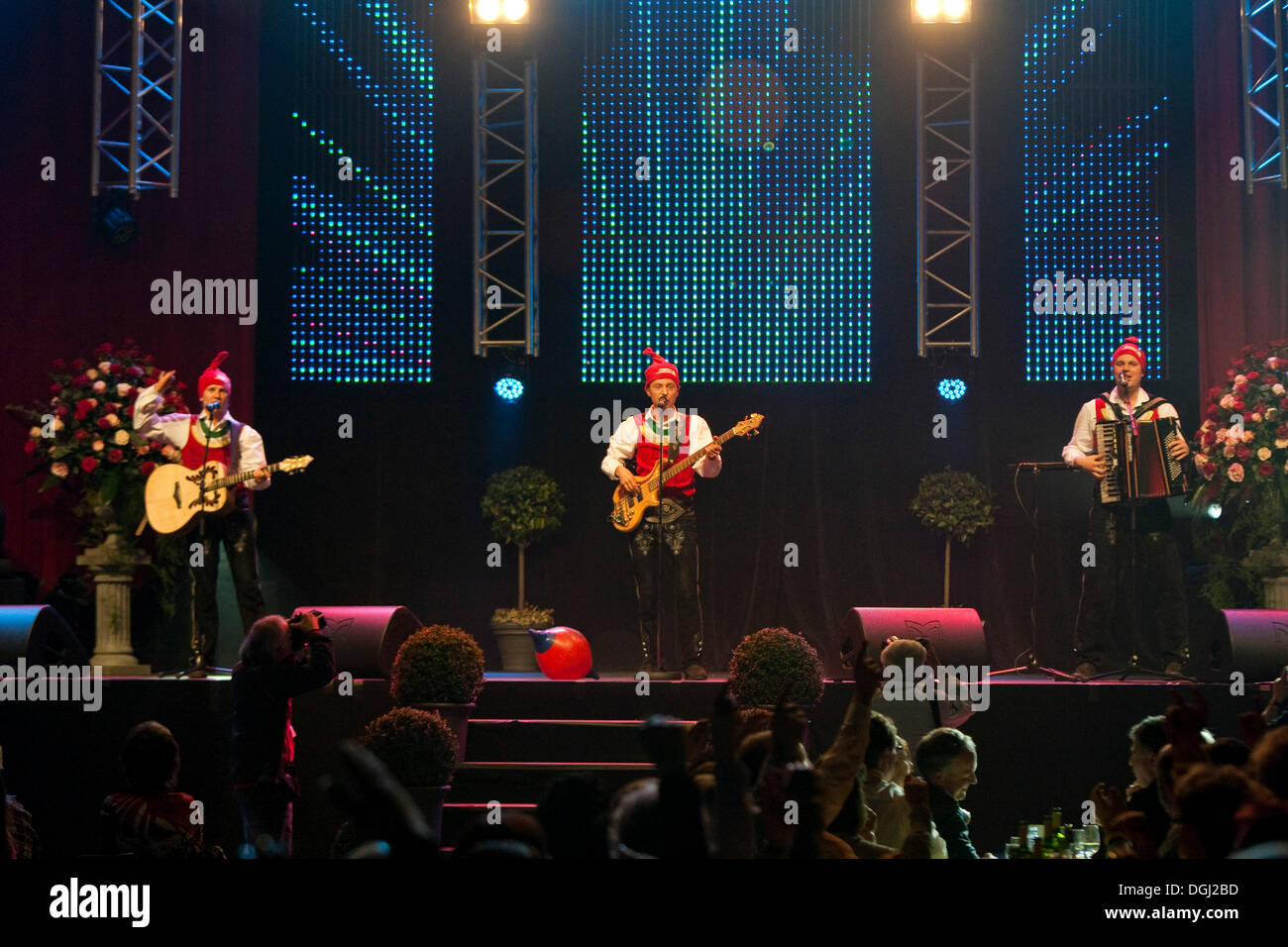 Austrian folk music and pop group Die jungen Zillertaler performing live at the 10th Schlager-Night in the new Allmend Stock Photo