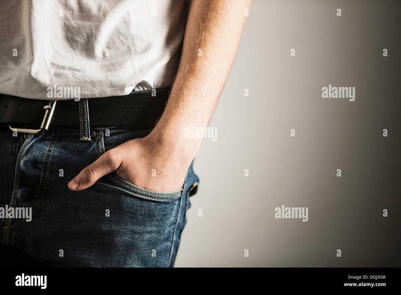 Cropped shot of hand inside pocket of jeans - Stock Image
