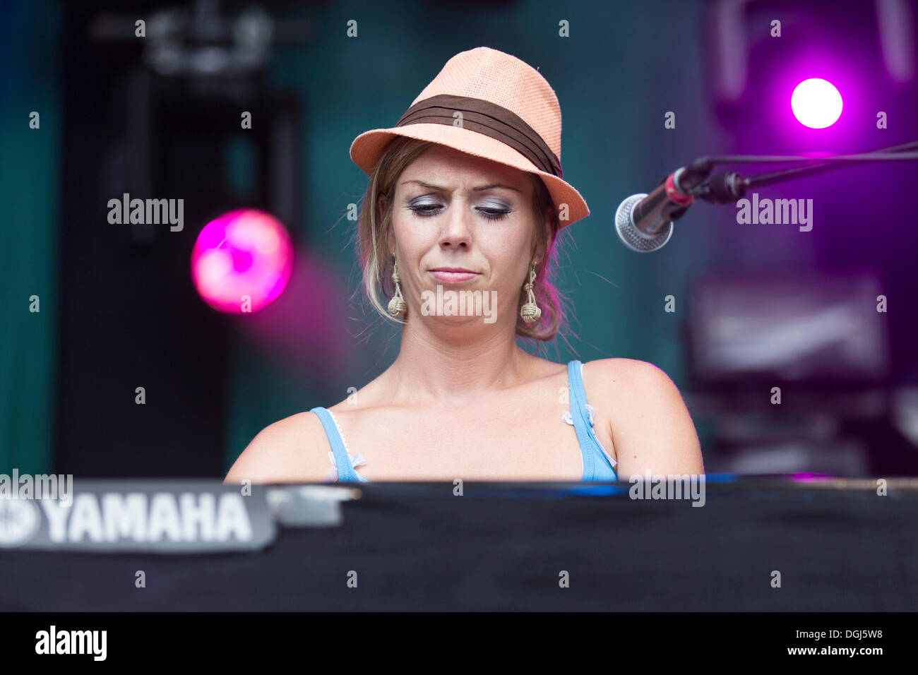 Turid Jørgensen playing keyboard from the Norwegian girl band Katzenjammer performing live at Heitere Open Air in Stock Photo