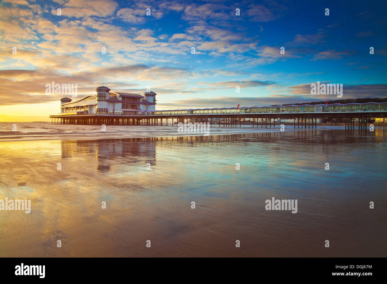 Golden evening light falls on the Grand Pier at Weston Super Mare. - Stock Image