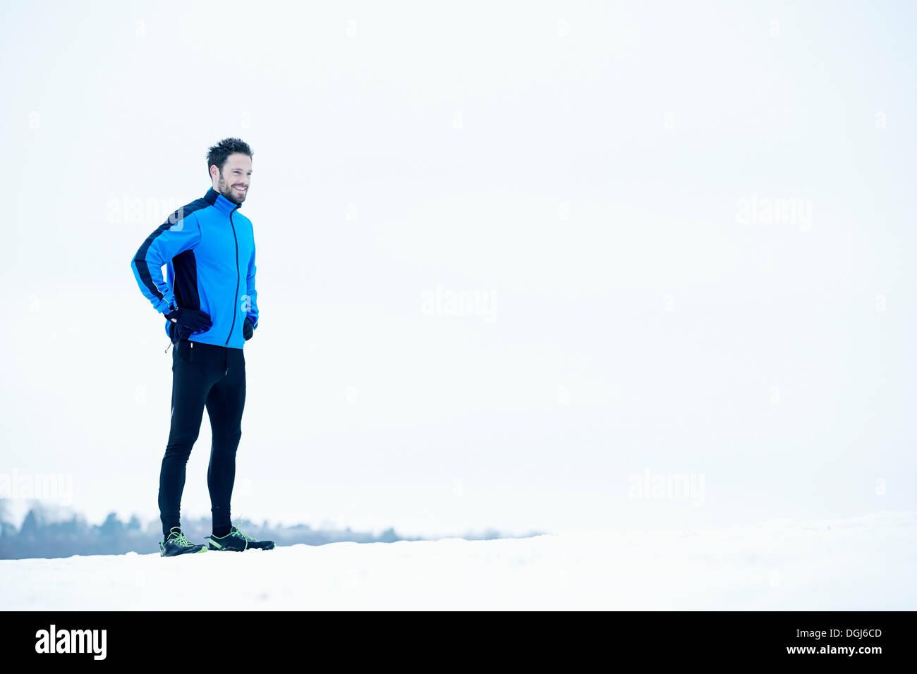 Man preparing for snow run Stock Photo