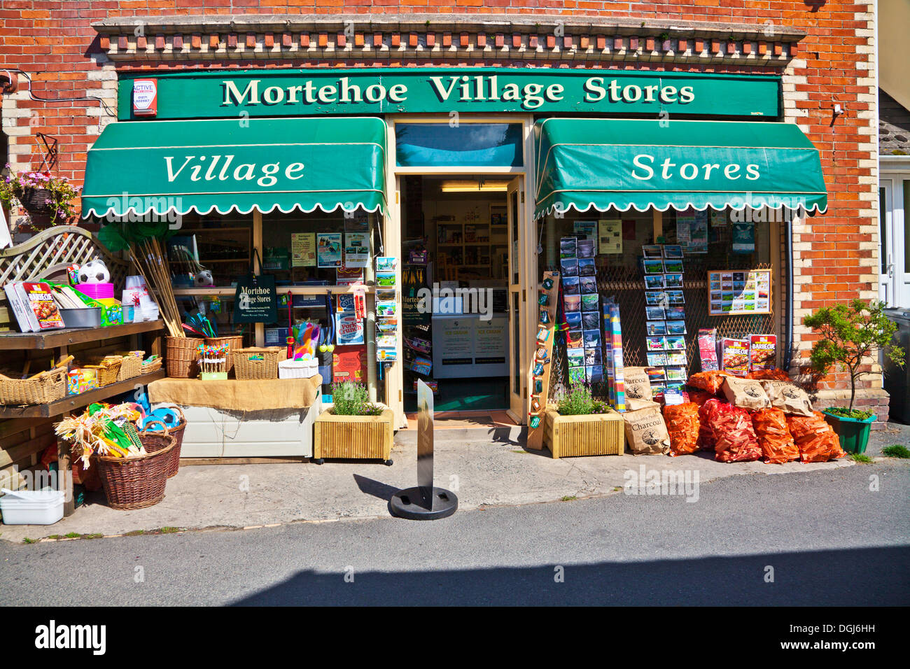 Typical English village grocery shop in the pretty holiday resort of Morthoe. - Stock Image