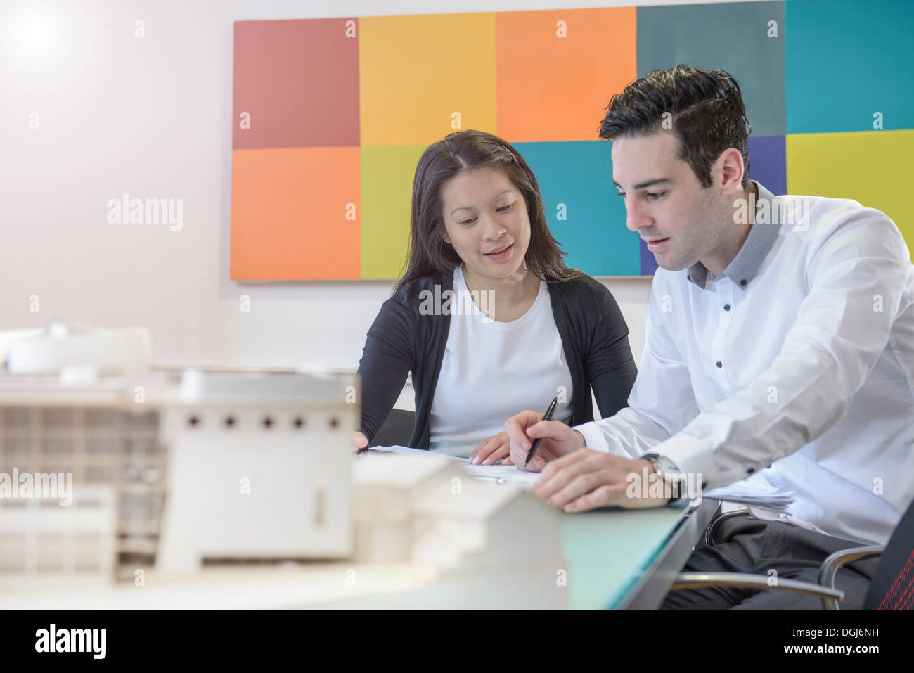 Architects working together in office - Stock Image