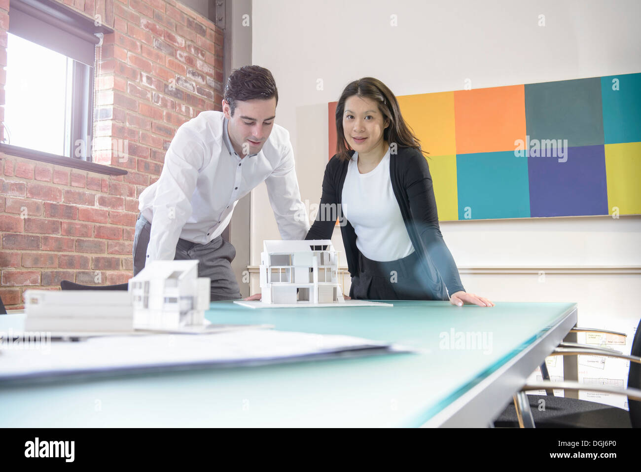 Architect working with colleague in office, portrait - Stock Image