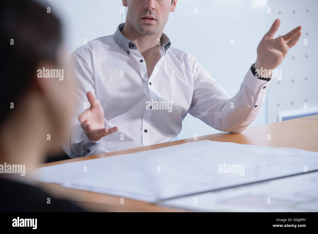 Man gesturing in business meeting, close up - Stock Image