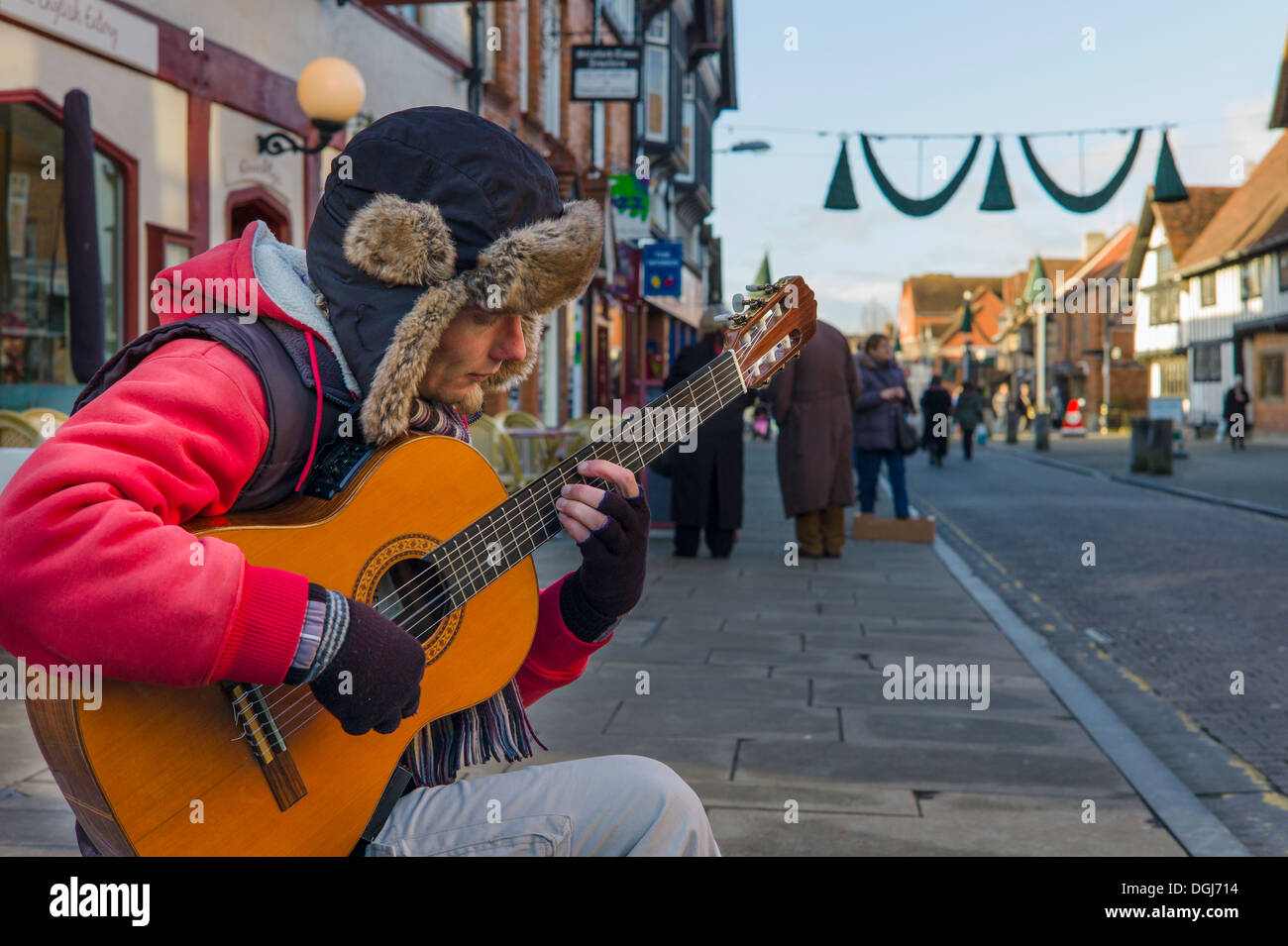 A busker playing classical guitar in Stratford-upon-Avon. - Stock Image