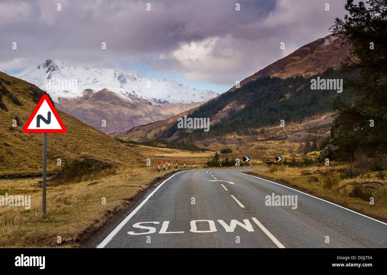 Road signs on the twisting road through Glen Shiel. - Stock Image
