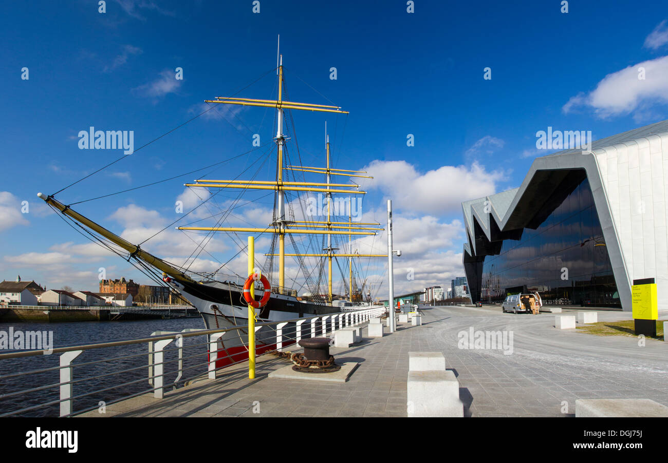 Rear of Glasgow Riverside Museum and the tall ship Glenlee moored in the Clyde. - Stock Image