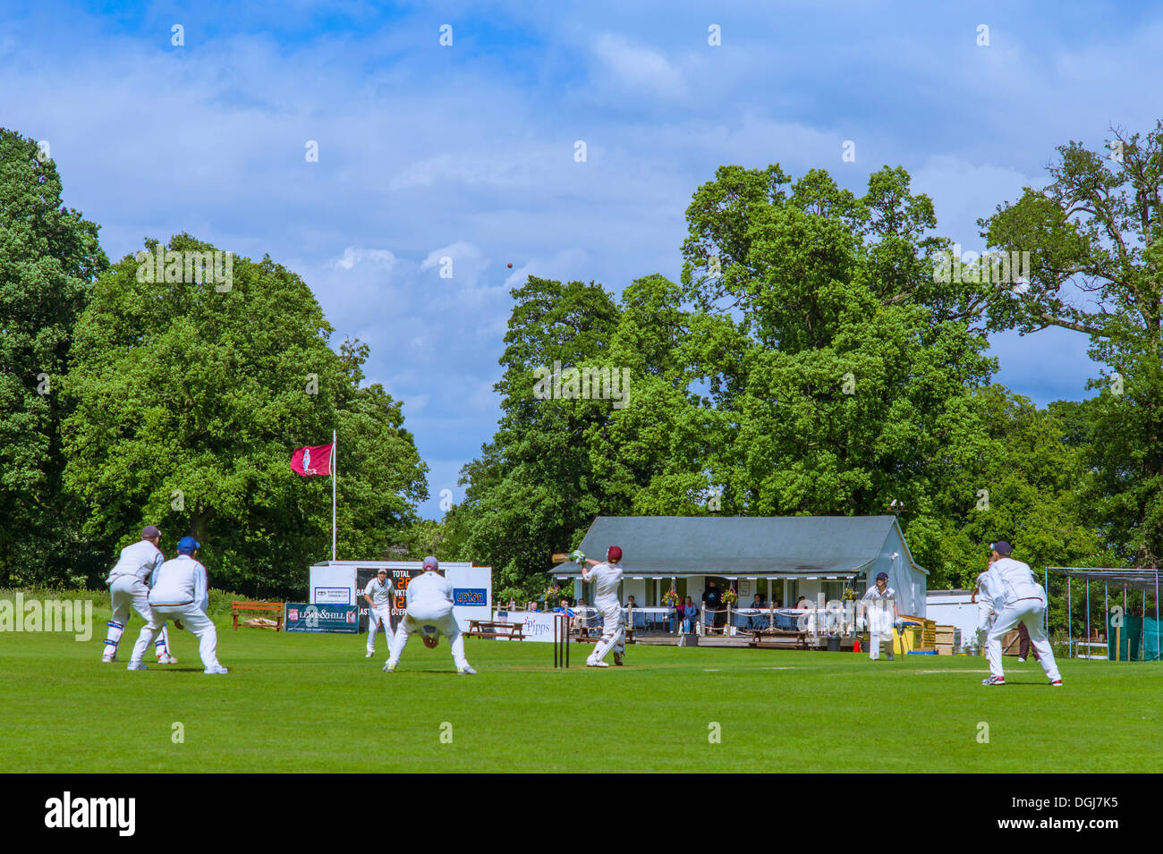 The ball flies high in the air as the batsman tries for the boundary. - Stock Image