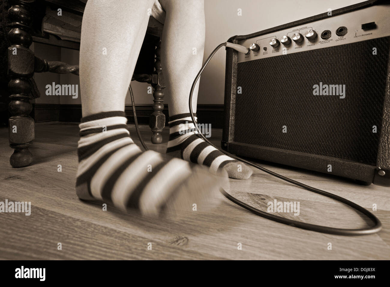 A foot tapping in time with music. - Stock Image