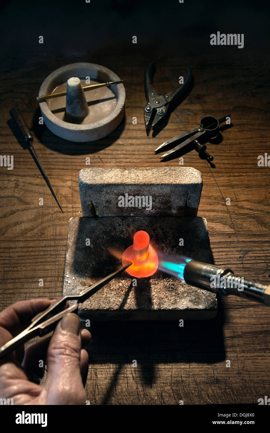 Blowlamp being used to solder silver. - Stock Image