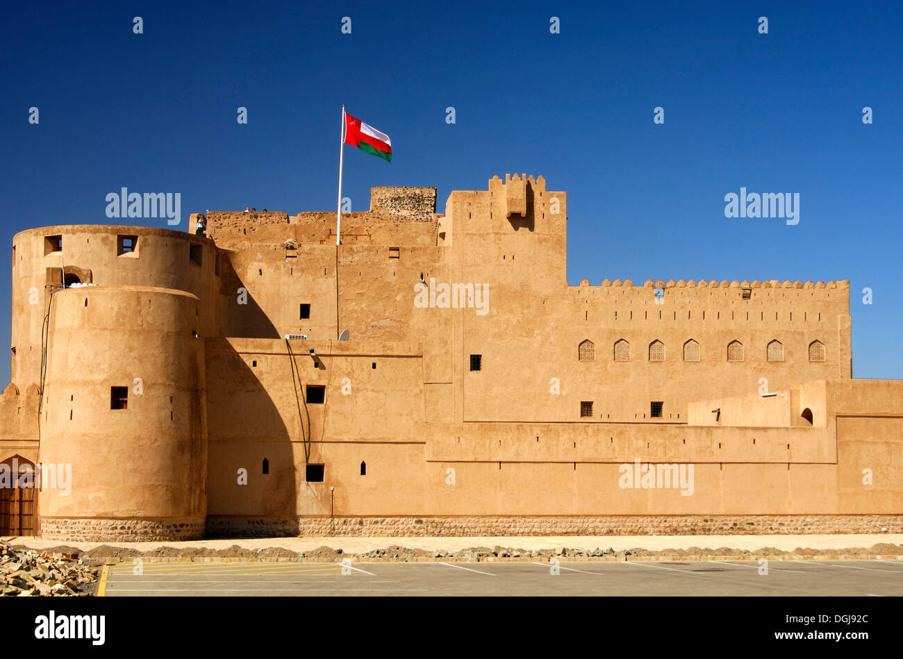 Fort Jabrin flagged with National Flag of Oman, historical clay-made fort in the Dhakiliya Region, Sultanate of Stock Photo