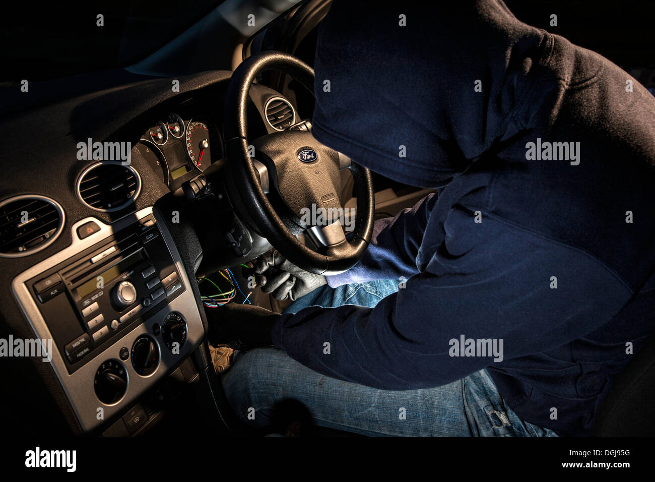 A man ing a hoody hot wiring a car Stock Photo: 61867948 ... Hot Wiring on