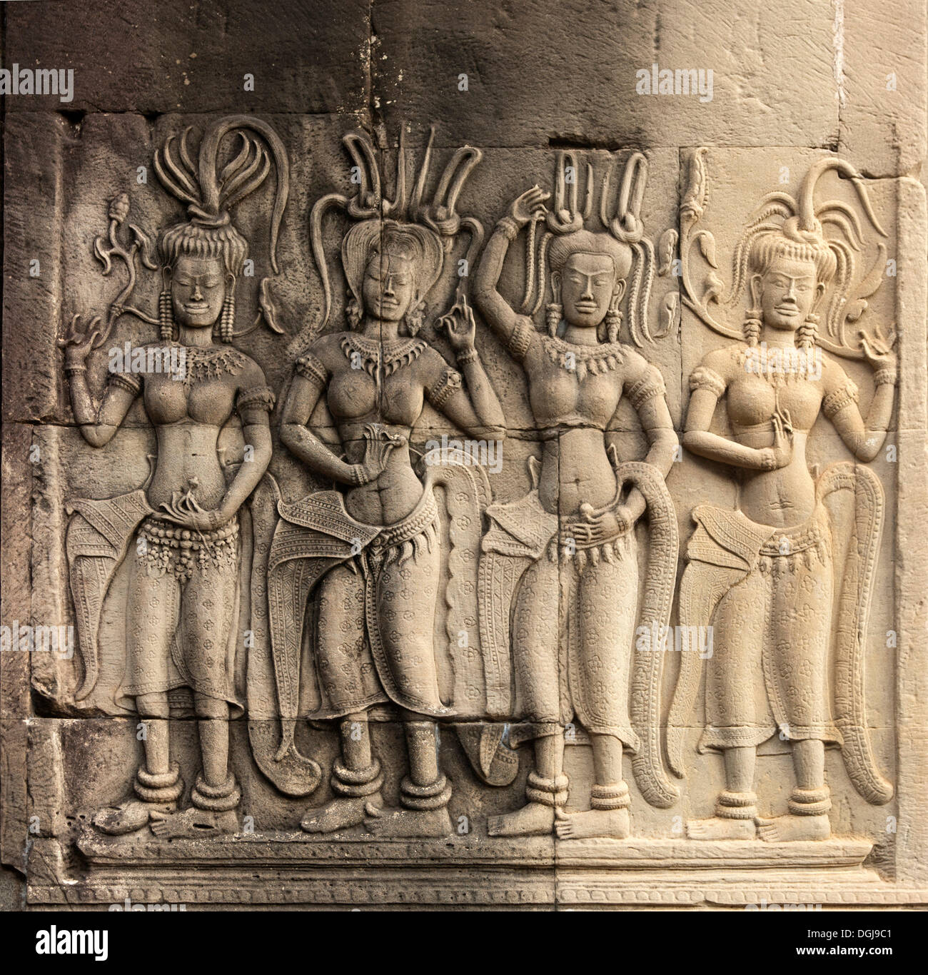 Bas-relief of a group of Devatas or divine temple guardians, gallery on the second level, Angkor Wat Temple Complex, Siem Reap - Stock Image