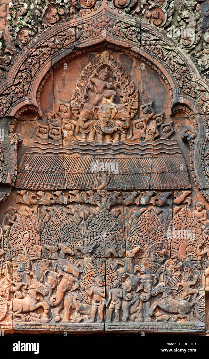 Indra, god of the sky, releasing rain in an attempt to extinguish the fire created by Agni, part of the bas-reliefs of the - Stock Image