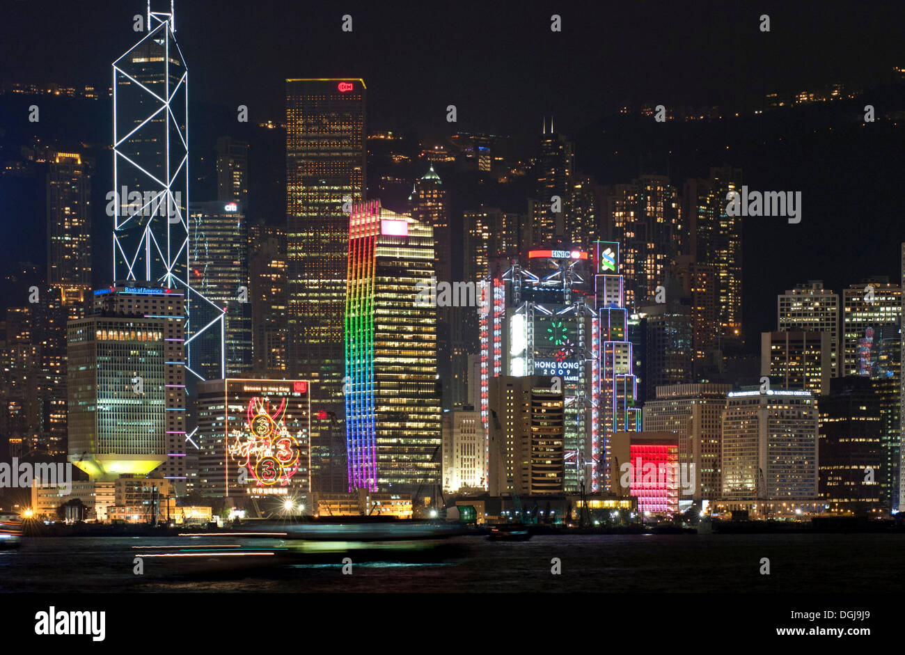 Laser light show on the skyscrapers of the Central District of Hong Kong Island as seen from Kowloon, Hong Kong, China, Asia - Stock Image