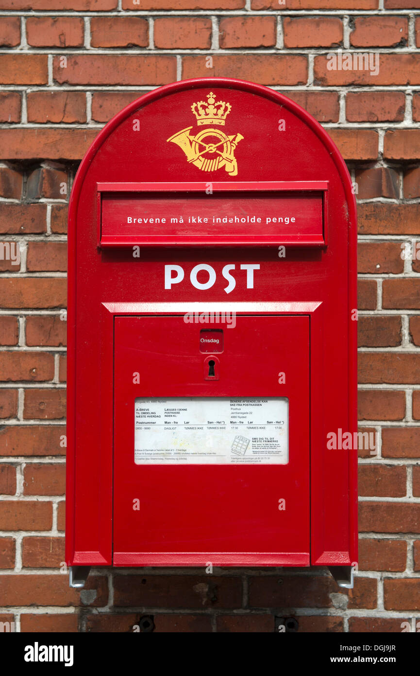 Red letter box of the Danish postal service Post Danmark, Nysted, Denmark, Europe - Stock Image