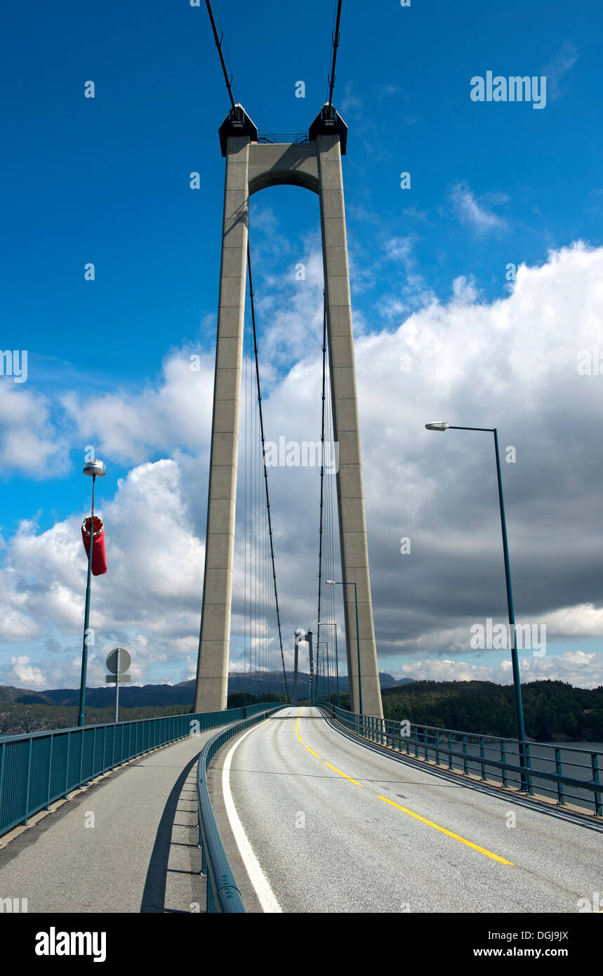 Reinforced concrete pylon of the Stordabrua or Stord suspension bridge across the Digernessundet sound as a connection between - Stock Image