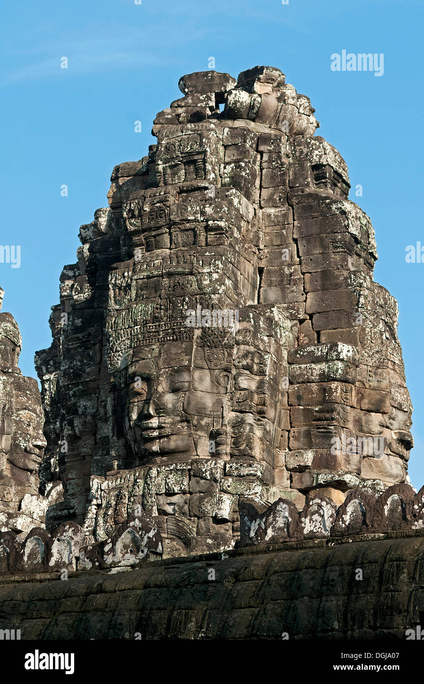 View towards one of the more than 50 mystical towers of Bayon Temple with huge carved stone faces, Bayon, Angkor Thom, Siem Reap - Stock Image