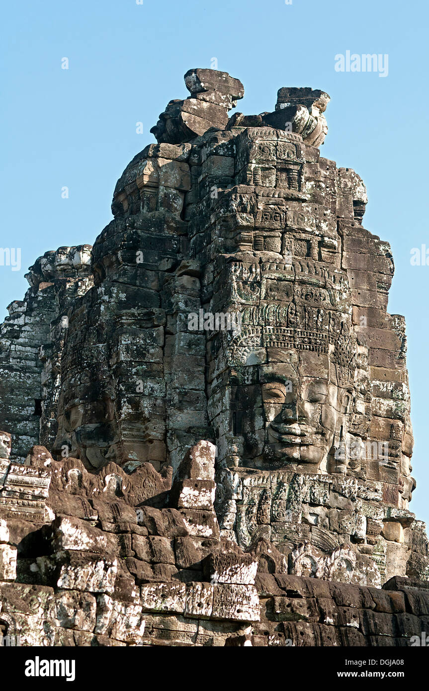 One of the more than 50 mystical towers of Bayon Temple with huge carved stone faces, Bayon, Angkor Thom, Siem Reap, Cambodia - Stock Image