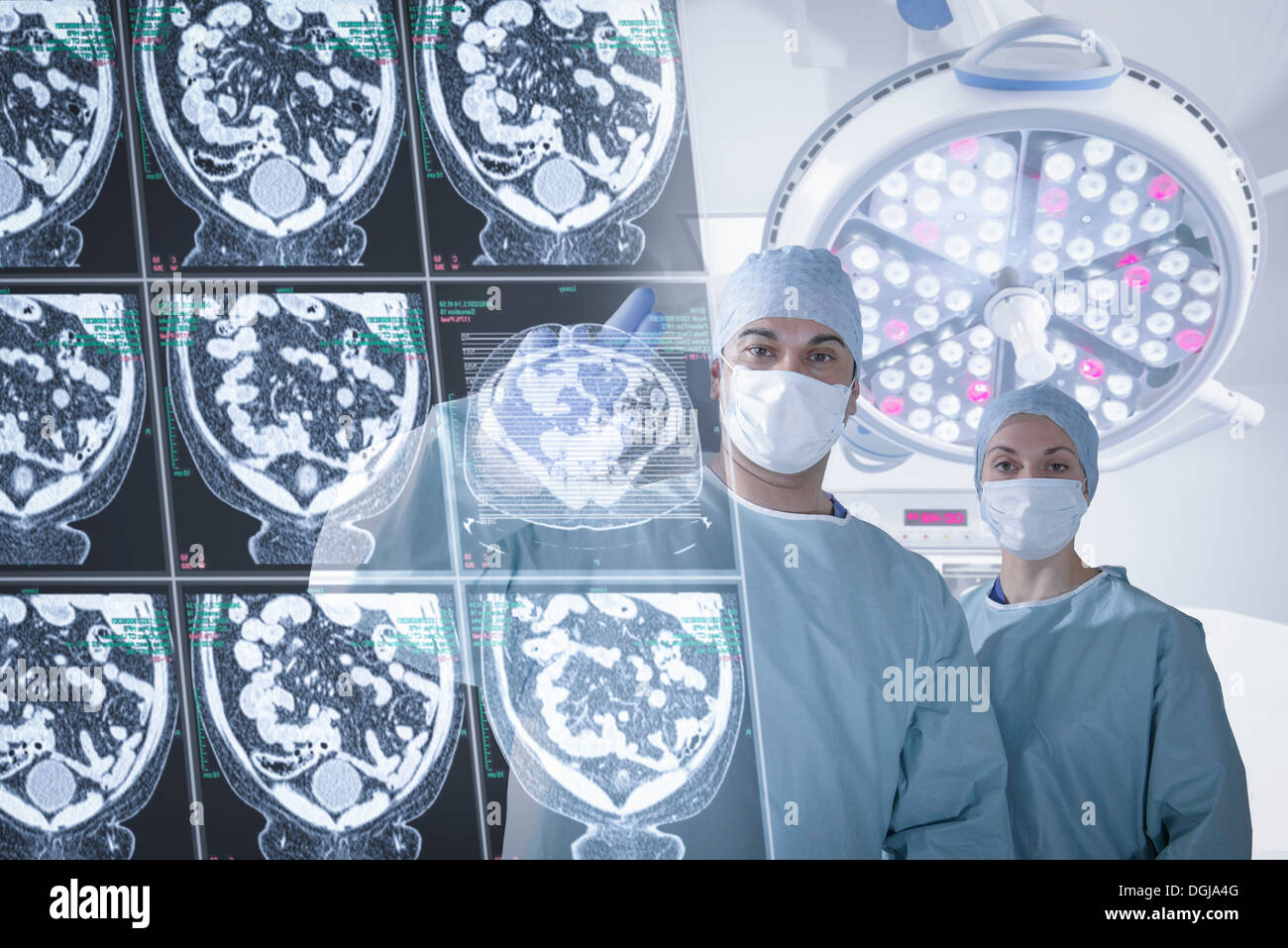 Surgeons discussing computed tomography (CT) scans in operating theatre - Stock Image