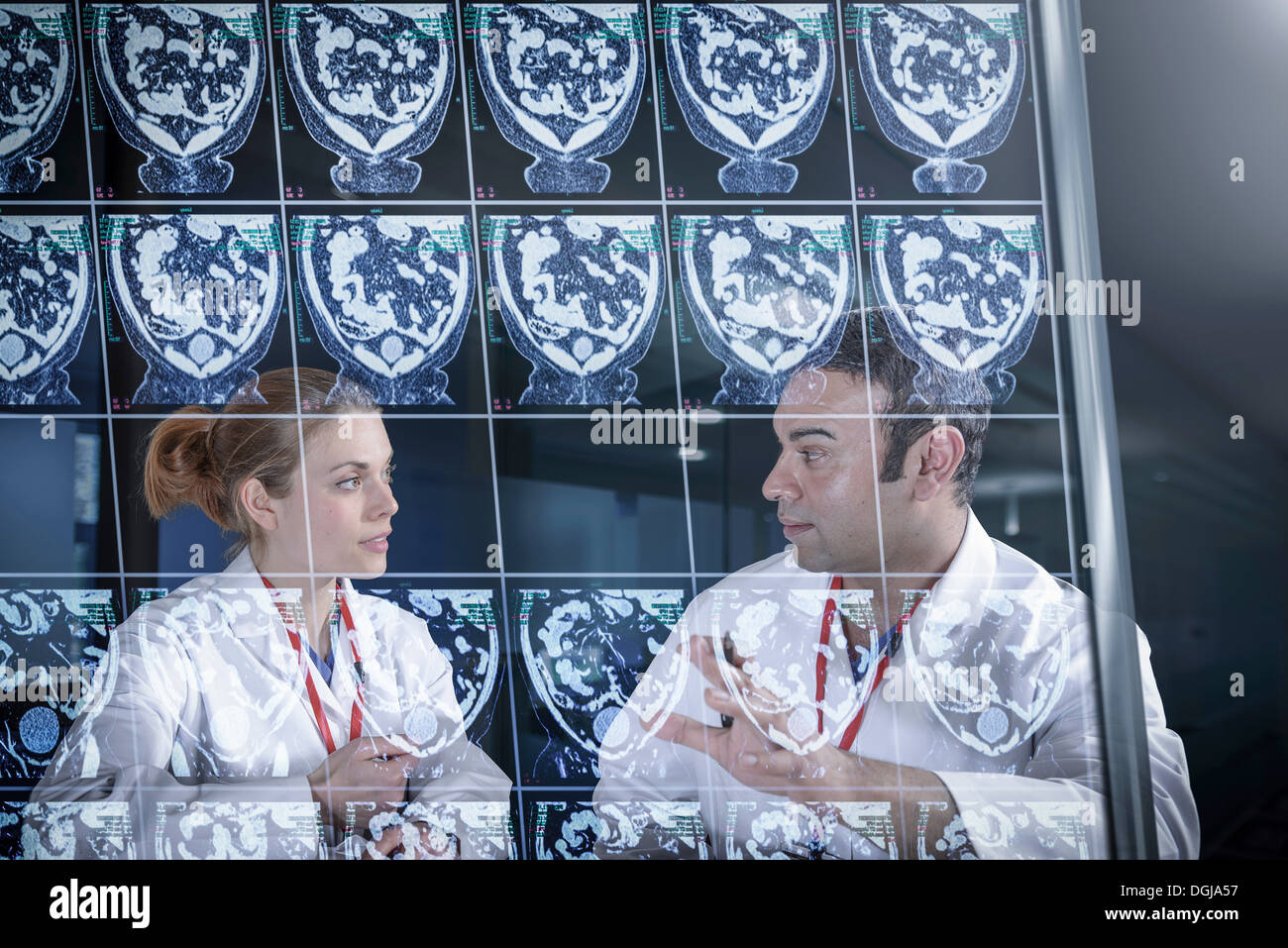Doctors discussing computed tomography (CT) scans on screen Stock Photo