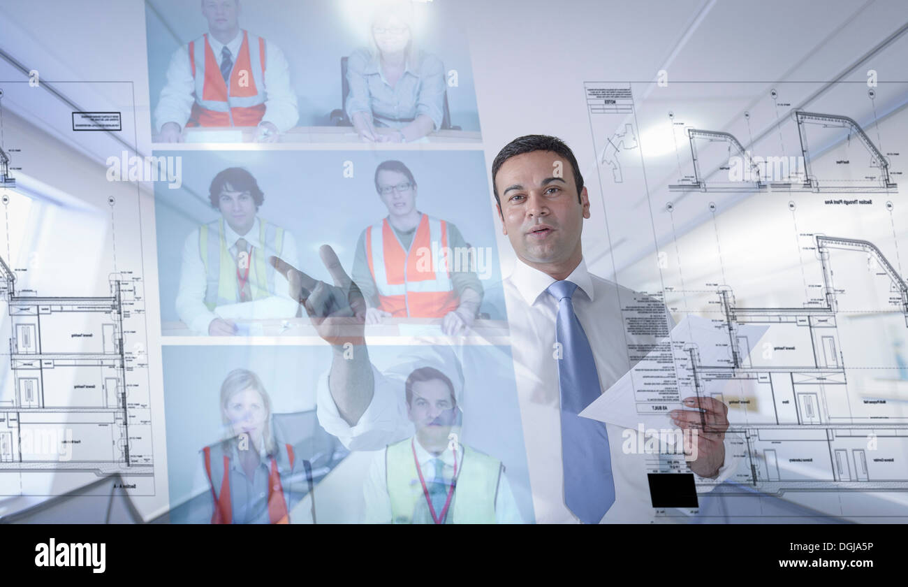 Businessman in video conference, view through screen - Stock Image