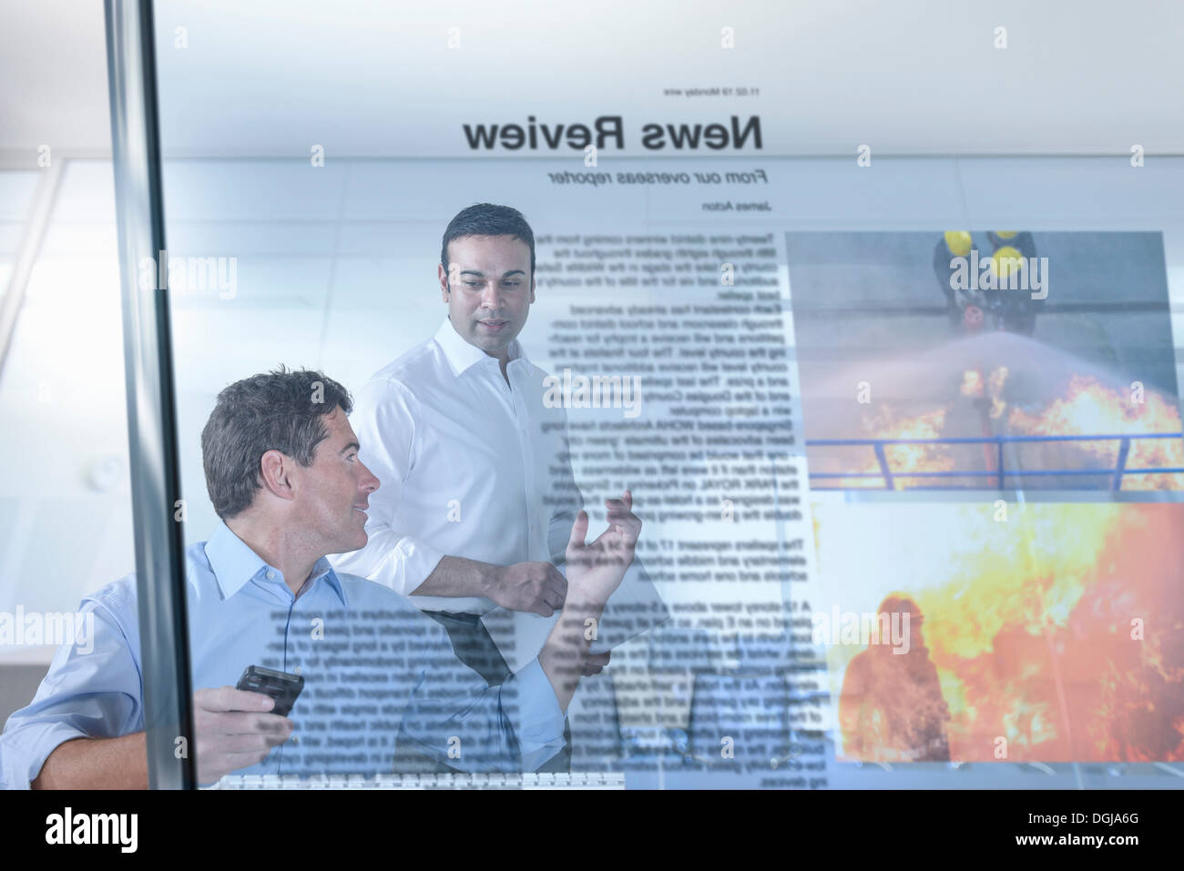 Journalist and blogger discussing news, view through screen - Stock Image