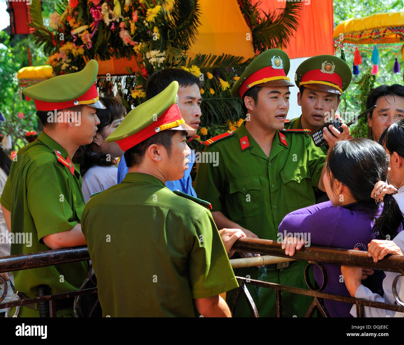 Police officers maintaining order at the largest and most important religious festival of the Cham, Po Nagar Temple, - Stock Image
