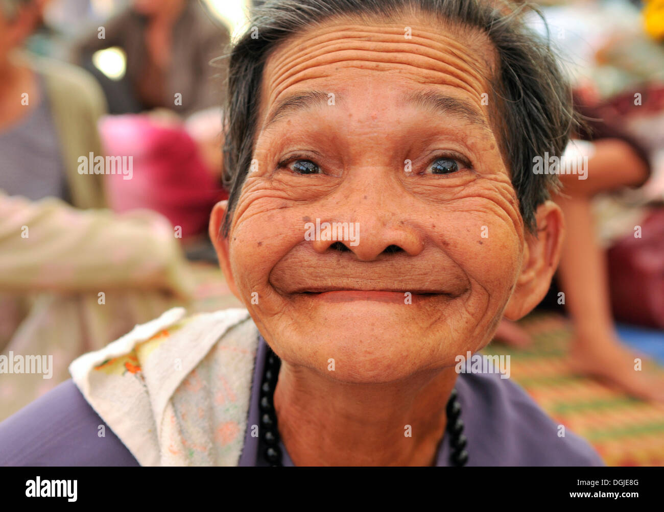 Grimacing old woman, Vietnam, Southeast Asia - Stock Image