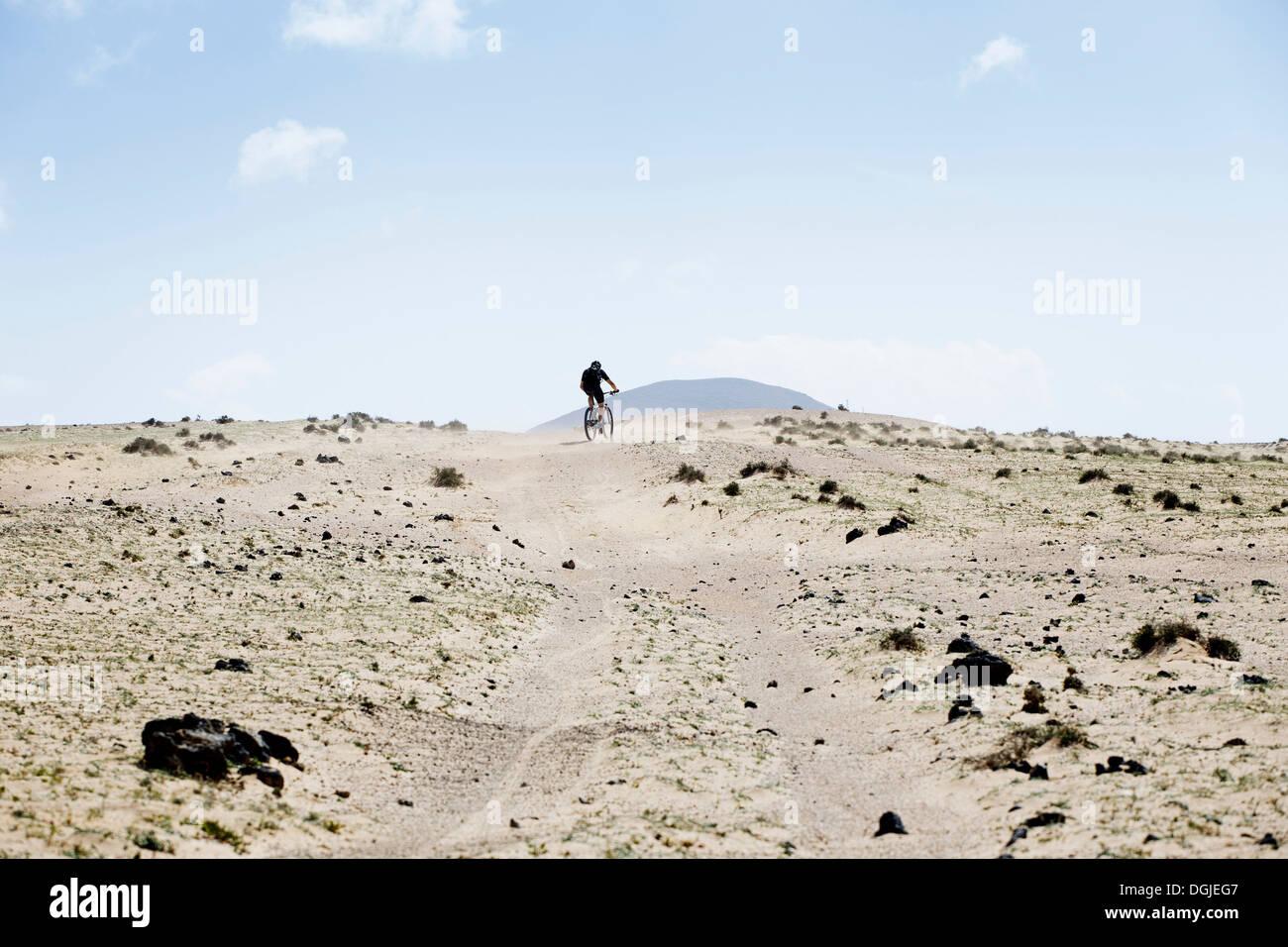 Man mountain biking, Lanzarote - Stock Image