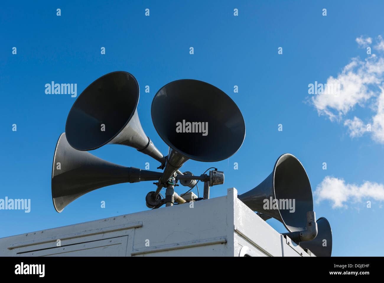 PA system megaphones on top of hut Derbyshire England - Stock Image