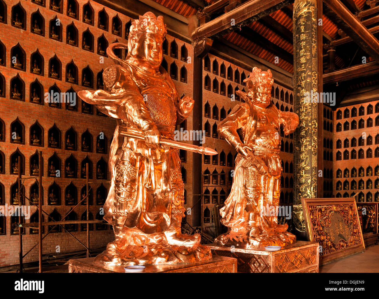 Restored statues on the construction site of the Chua Bai Dinh pagoda, one of the largest pagodas in Southeast Asia - Stock Image